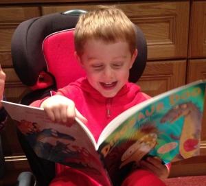 Daniel delighting at Dinosaur Doo